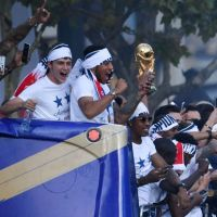 MLST SPORT:France fans pack Champs Elysees in Paris to get glimpse of World Cup winners
