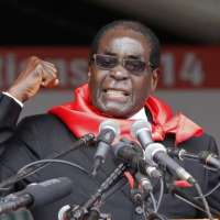Mugabe's body heads for wake in home village